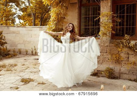 Beautiful Bride Woman In Blowing Wedding Dress Outdoors, Autumn Park.