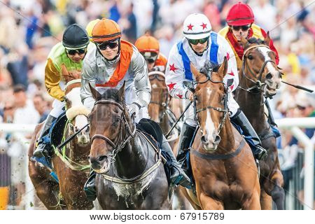 Closeup Of Jockeys Into Last Curve At The Nationaldags Galoppen