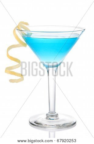 Blue Tropical Martini Cocktail With Yellow Lemon Spiral
