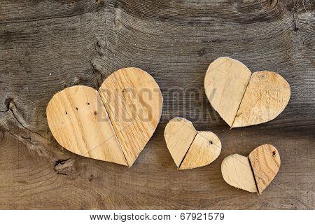 Four Love Valentines Wooden Hearts On Old Elm Background