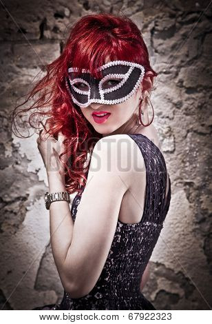Masquerade. Beautiful girl in a carnival mask. Bokeh
