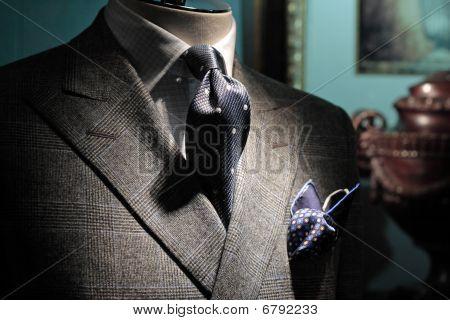 Grey Checkered Jacket, Dark Blue Tie And Handkerchief