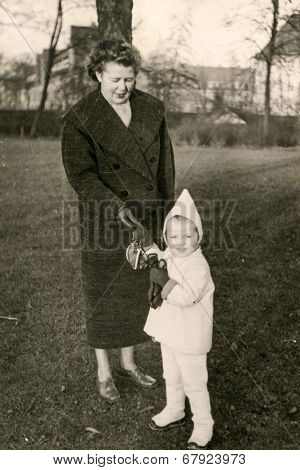 GERMANY, CIRCA FIFTIES - vintage photo of mother and daughter
