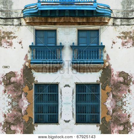 Eroded Old Havana Facade With Blue Windows