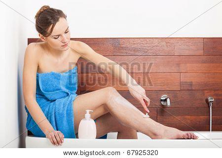 Beautiful Woman Shaving Legs