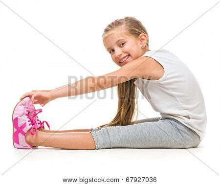 happy little girl goes in for sports. studio shot isolated on white