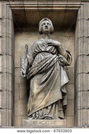 PARIS, FRANCE - NOV 09, 2012: Saint Agatha of Sicily, architectural details of Eglise de la Madeleine. Madeleine Church was designed in its present form as a temple to the glory of Napoleon's army.