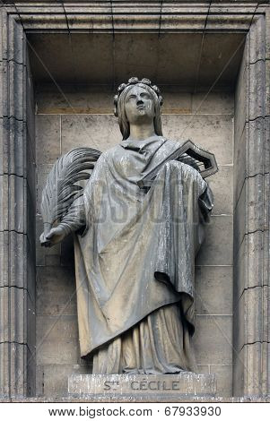 PARIS,FRANCE - NOV 09,2012: Saint Cecilia, architectural details of Eglise de la Madeleine. Madeleine Church was designed in its present form as a temple to the glory of Napoleon's army.