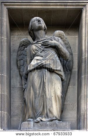 PARIS,FRANCE - NOV 09,2012: Archangel Michael, architectural details of Eglise de la Madeleine. Madeleine Church was designed in its present form as a temple to the glory of Napoleon's army.