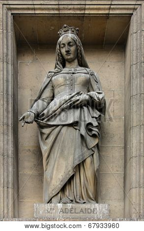 PARIS,FRANCE - NOV 09,2012: Saint Adelaide of Italy, architectural details of Eglise de la Madeleine. Madeleine Church was designed in its present form as a temple to the glory of Napoleon's army.