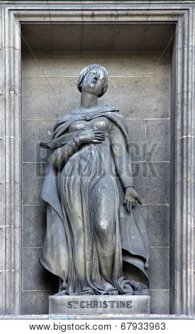 PARIS,FRANCE - NOV 09,2012: Saint Christina, architectural details of Eglise de la Madeleine. Madeleine Church was designed in its present form as a temple to the glory of Napoleon's army.