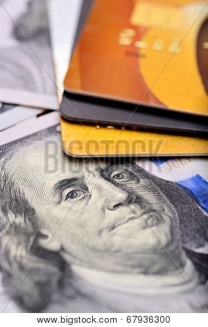Close-up credit cards on dollars notes with shallow depth of field