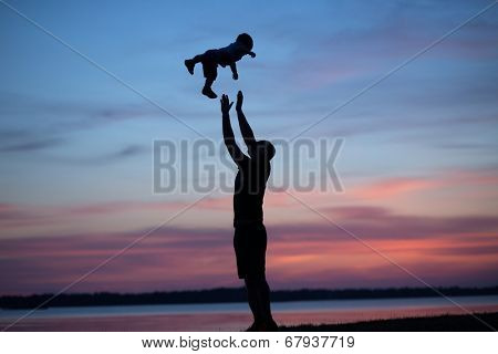 Young dad playing with his son