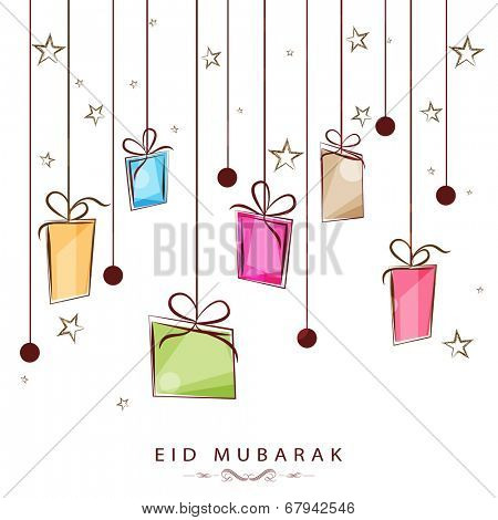 Hanging colorful gift boxes on stars decorated white background for the occasion of Muslim community festival Eid Mubarak.