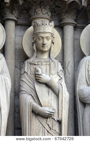 PARIS, FRANCE - NOV 05, 2012: Queen, architectural detail of Notre Dame cathedral. Portal of St. Anne was the first of the three west portals to be installed (c.1200).
