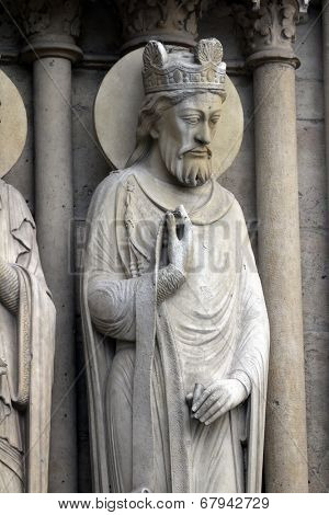 PARIS, FRANCE - NOV 05, 2012: King, architectural detail of Notre Dame cathedral. Portal of St. Anne was the first of the three west portals to be installed (c.1200).