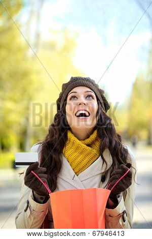 Blissful Woman With Shopping Bags And Credit Card