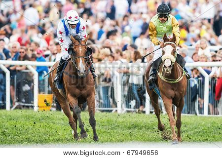 Two Jockeys Into Last Curve At The Nationaldags Galoppen