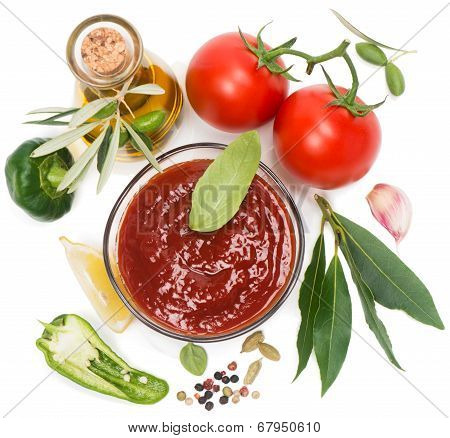 View From Above Of  Bowl Of Tomato Sauce With Fresh Ingredients On White