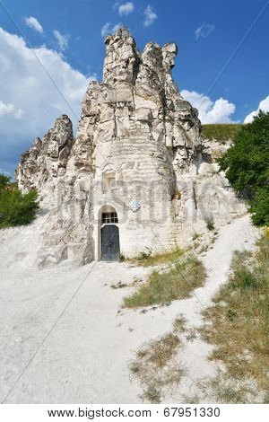 DIVNOGORIE, VORONEZH REGION, RUSSIA - JUNE 8, 2014: People near the cave church of Sicilian Icon of the Mother of God. The church was found in XVII century, and last time restored in mid 1990s