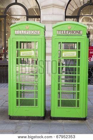 LONDON, UK - JULY 03, 2014: British telephone box in green. Bank of England.