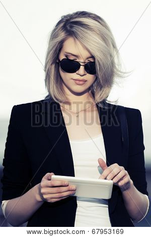 Young fashion business woman using tablet computer