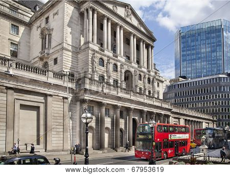 LONDON, UK - JUNE 30, 2014: Bank of England building. Square and busy road in front of bank