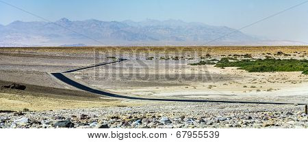 driving on the Interstate 187 in Death valley direction Badwater in the heat of the Mojave Desert