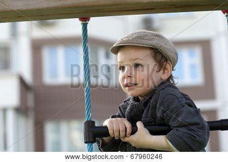Boy Climbing A Rope Ladder