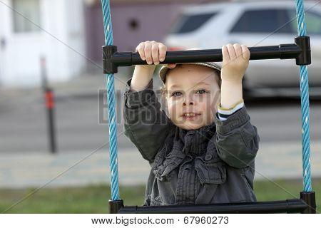 Boy On A Rope Ladder