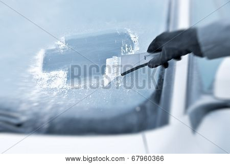 Winter driving - Scraping ice from a windshield