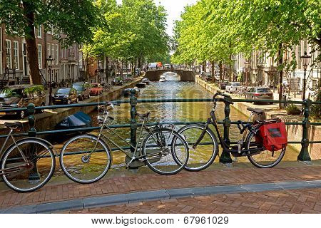 Amsterdam - Bicycles On A Bridge Over The Canal