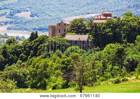 Rural Landscape With Houses Standing Alone In The Province Of Tuscany