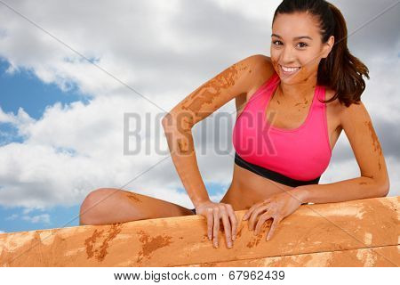 Woman competing in a mud run race