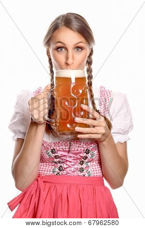 Attractive Woman In A Dirndl Drinking Beer