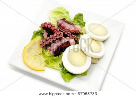 Appetizer Of Boiled Egg And Octopus Tentacles