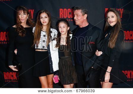 NEW YORK-MAR 13: Jennifer Flavin (L), Sylvester Stallone (2nd R) and daughters Sophia, Sistene and Scarlet attend 'Rocky' Broadway opening night at Winter Garden on March 13, 2014 in New York City.