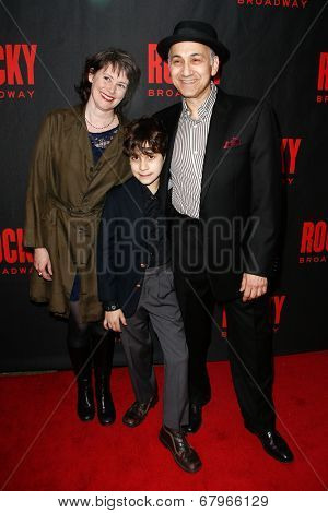 NEW YORK-MAR 13: Actor Ned Eisenberg (R) and family attend the 'Rocky' Broadway opening night after party at Roseland Ballroom on March 13, 2014 in New York City.