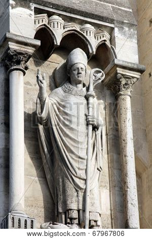 PARIS, FRANCE - NOV 05,2012: Pope statue, architectural detail of Cathedral Notre Dame de Paris, most famous Gothic, Roman Catholic cathedral (1163-1345) on eastern half of Cite Island. France