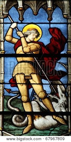 PARIS, FRANCE - NOV 11, 2012: Saint George slaying the dragon, stained glass. The Church of St Severin is Catholic church in the Latin Quarter. It is one of the oldest churches on the Left Bank.