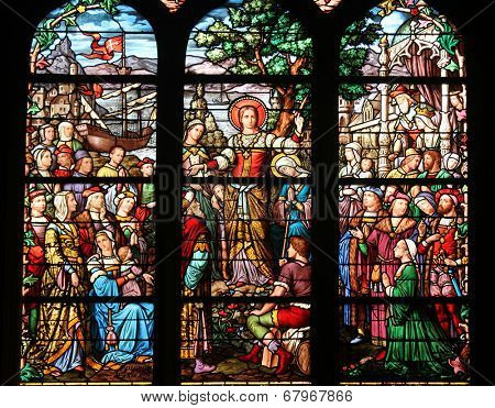 PARIS, FRANCE - NOV 11, 2012: Saint Mary Magdalene, stained glass. The Church of St Severin is Catholic church in the Latin Quarter. It is one of the oldest churches on the Left Bank.