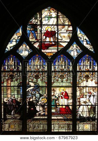 PARIS, FRANCE - NOV 11, 2012: St. Aloysius Gonzaga receiving first communion from the hands of Saint Charles Borromeo, stained glass. The Church of St Severin is Catholic church in the Latin Quarter.