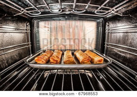 Baking pastry in the oven, view from the inside of the oven. Cooking in the oven.
