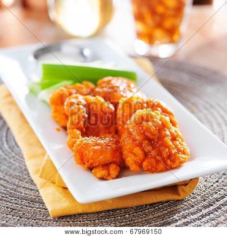 plate of boneless buffalo flavored chicken wings