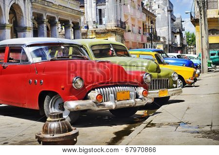 HAVANA, CUBA - JULY 14, 2009: Group of classic vintage american cars parked, commonly used as private taxis in Havana, Cuba.