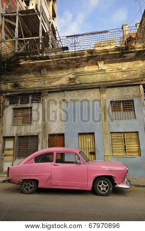 HAVANA, CUBA - JULY 9, 2010. Vintage American car commonly used as private taxi parked in Havana street.