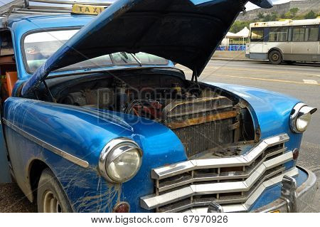 HAVANA, CUBA - DEC 3, 2008: Detail of vintage classic car commonly used as private taxi with opened trunk.