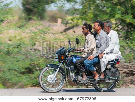 Three Generations, Riding On One Motorbike In India.