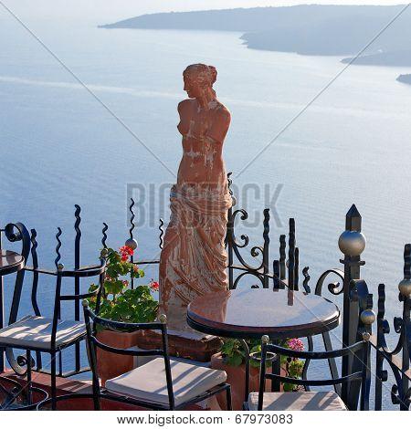 Santorini Greece, Statue Of Aphrodite In Outdoor Cafe