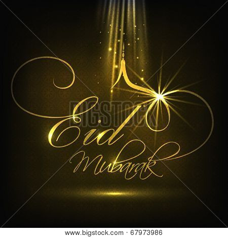 Shiny golden text Eid Mubarak on black background for Muslim community festival Eid Mubarak celebrations.